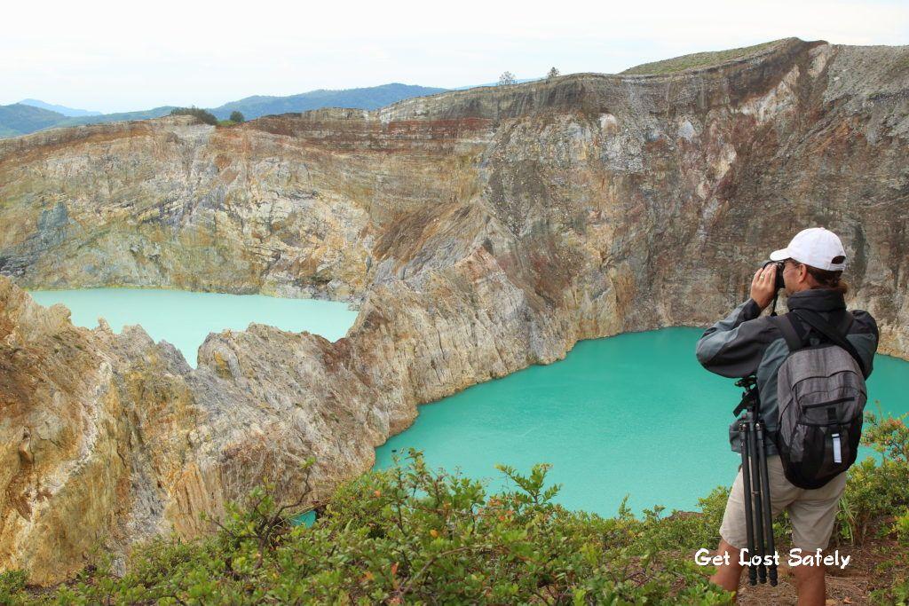 Photographer taking photo of Kelimutu Lake